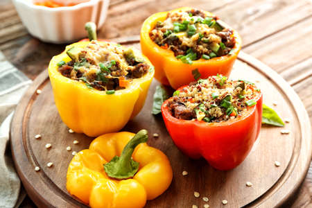 Photo pour Quinoa stuffed peppers on wooden board - image libre de droit