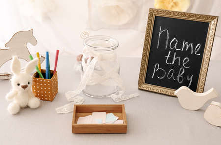 Photo for Game for suggestion of baby name on table at shower party - Royalty Free Image