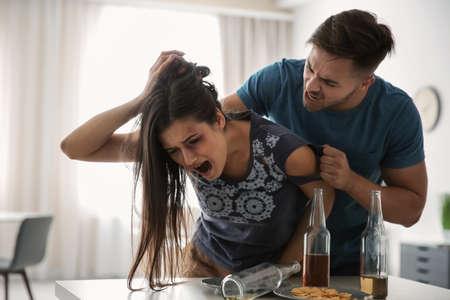 Photo pour Young woman subjecting to violence at home - image libre de droit