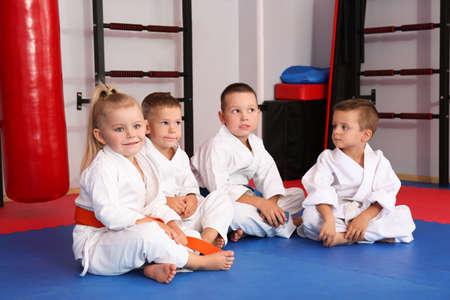Photo for Little children wearing karategi in dojo - Royalty Free Image