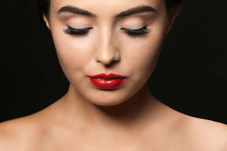 Photo for Beautiful young woman with eyelash extensions on dark background - Royalty Free Image