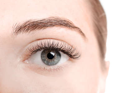 Photo for Young woman with eyelash extensions on white background, closeup - Royalty Free Image