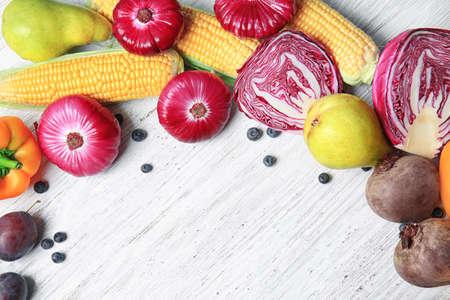 Photo pour Composition of different fruits and vegetables on white wooden background - image libre de droit