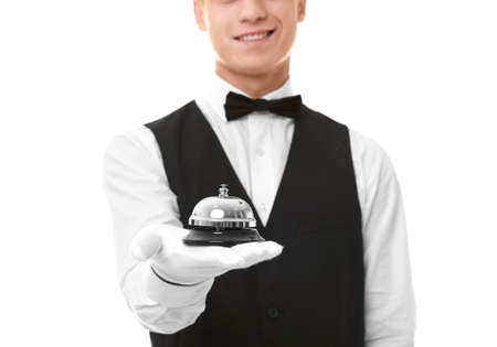Photo pour Waiter with service bell on white background - image libre de droit