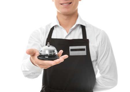 Photo pour Waiter with service bell on white background, closeup - image libre de droit