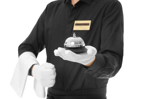 Photo pour Waiter with service bell on white background, closeup - image libre de droit