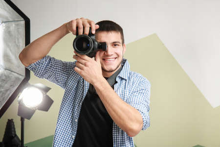 Photo for Young photographer working in professional studio - Royalty Free Image