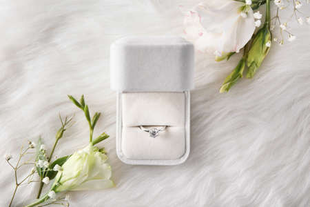 Photo for Box with luxury engagement ring on fur, top view - Royalty Free Image