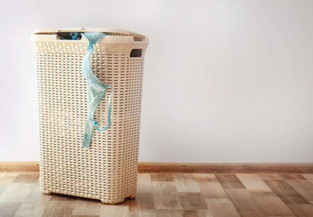 Photo pour Bin with dirty underwear prepared for laundry indoors - image libre de droit