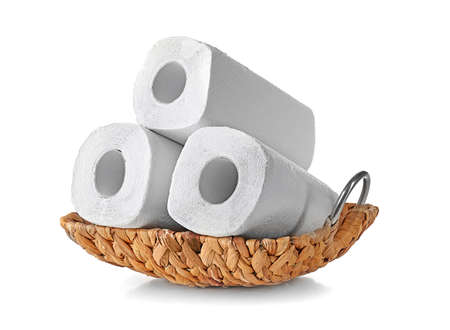 Photo for Wicker basket with rolls of paper towels on white background - Royalty Free Image