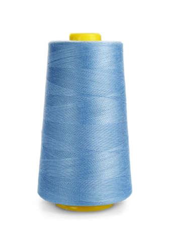 Foto de Spool of sewing thread on white background - Imagen libre de derechos