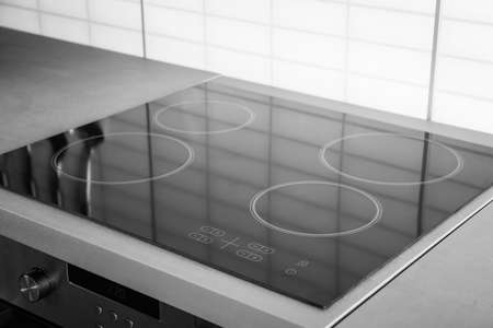 Photo for New electric stove with induction cooktop in kitchen, closeup - Royalty Free Image