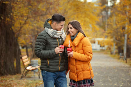 Photo for Beautiful couple in warm clothes in park - Royalty Free Image