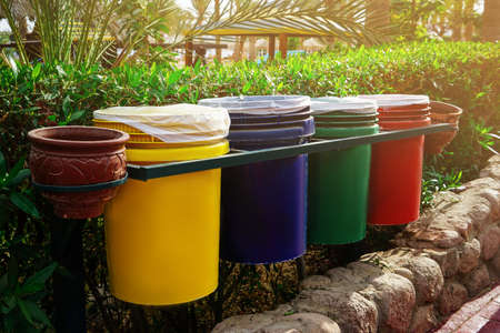 Foto de Different dustbins with trash outdoors. Recycling concept - Imagen libre de derechos