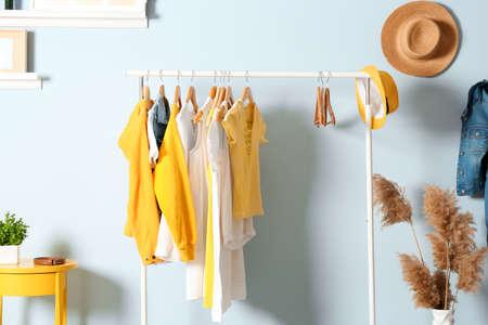 Foto de Collection of clothes hanging on rack in dressing room - Imagen libre de derechos