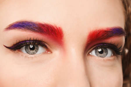 Photo pour Young woman with dyed eyebrows, closeup - image libre de droit