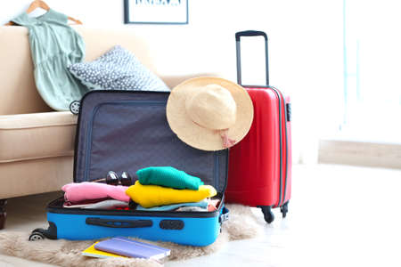 Photo pour Packed travel suitcases indoors - image libre de droit