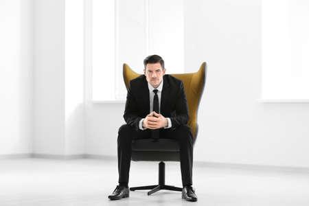 Foto de Handsome businessman sitting in comfortable armchair indoors - Imagen libre de derechos