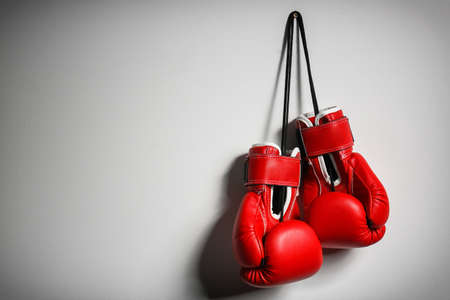 Foto de Boxing gloves on light background - Imagen libre de derechos