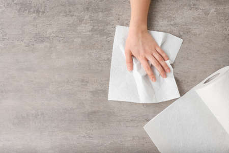 Photo for Woman wiping table with paper towel - Royalty Free Image