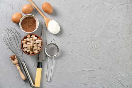 Foto de Set of kitchenware and products on grey background. Cooking master classes - Imagen libre de derechos