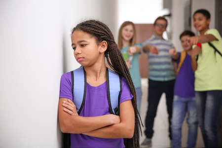 Photo pour Sad African American girl indoors. Bullying in school - image libre de droit
