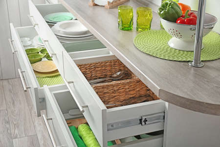 Photo pour Drawers with different kitchenware - image libre de droit