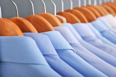 Photo pour Clean clothes on hangers after dry-cleaning, closeup - image libre de droit