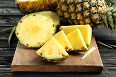 Photo for Fresh sliced pineapple on wooden board, closeup - Royalty Free Image