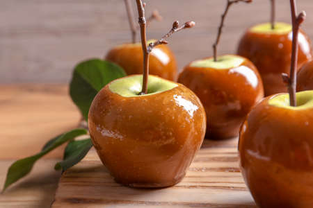 Photo for Delicious green caramel apples on table - Royalty Free Image