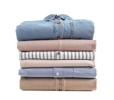 Photo pour Stack of clean clothes on white background - image libre de droit