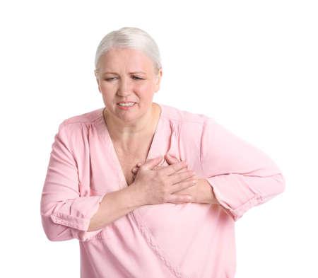 Foto de Mature woman having heart attack on white background - Imagen libre de derechos