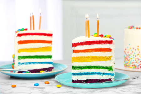 Photo for Delicious rainbow cake with candles for party on table - Royalty Free Image