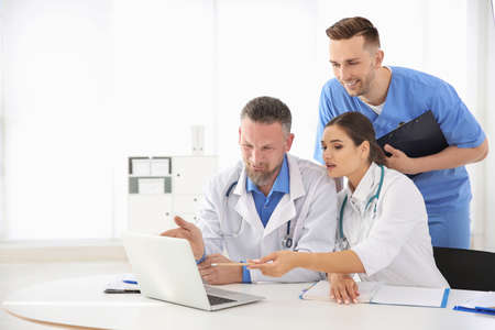 Photo for Group of doctors attending meeting in clinic. Cardiology conference - Royalty Free Image