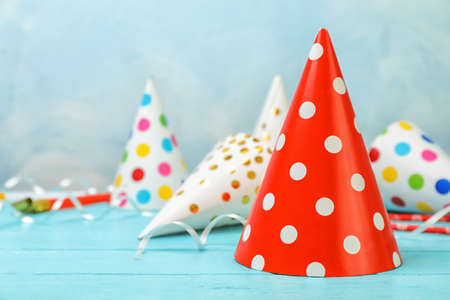 Photo for Birthday party caps on table against color background - Royalty Free Image
