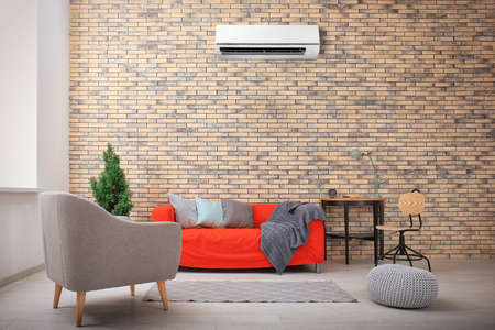 Photo pour Living room interior with comfortable sofa and air conditioner - image libre de droit