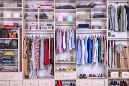 Photo pour Large wardrobe with different clothes, home stuff and shoes - image libre de droit