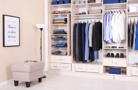 Photo pour Room interior with wardrobe and stylish ottoman chair - image libre de droit