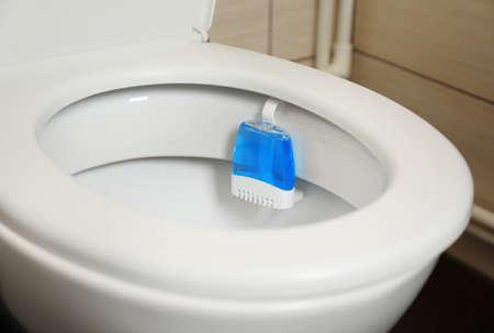 Photo pour Toilet with rim block in bathroom. Air freshener - image libre de droit