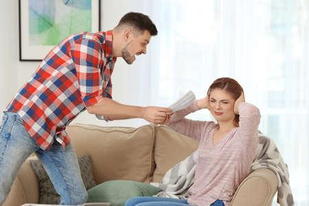 Photo pour Couple quarreling because of utility costs at home - image libre de droit