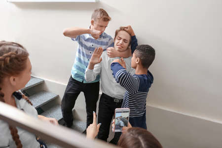 Photo pour Teenagers bullying their classmate at school - image libre de droit