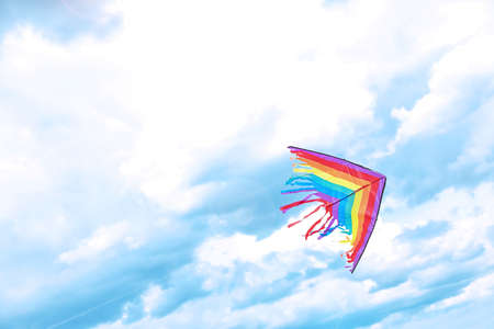 Foto de Beautiful kite drifting in blue sky - Imagen libre de derechos