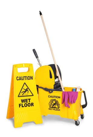 Photo pour Safety sign with phrase CAUTION WET FLOOR and mop bucket on white background. Cleaning tools - image libre de droit