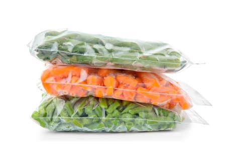 Photo pour Plastic bags with frozen vegetables on white background - image libre de droit