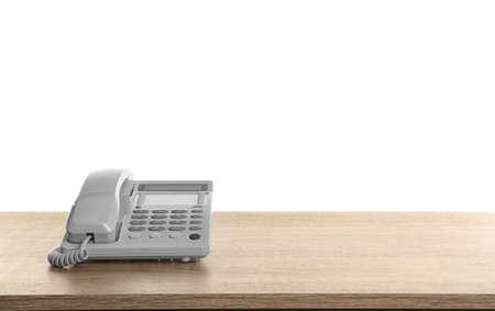 Photo pour Telephone on wooden table against white background - image libre de droit