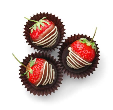 Foto de Delicious chocolate covered strawberries on white background, top view - Imagen libre de derechos