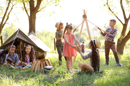 Photo pour Little children near tent outdoors. Summer camp - image libre de droit