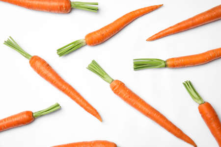 Photo pour Ripe fresh carrots on white background - image libre de droit