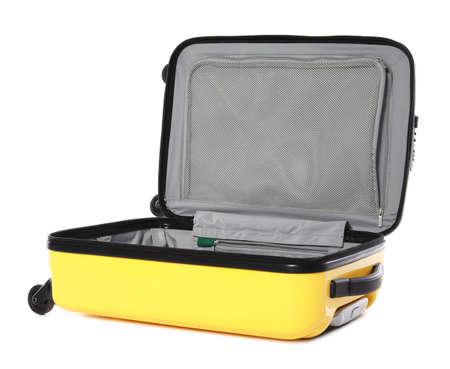 Photo pour Open bright yellow suitcase on white background - image libre de droit
