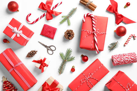 Foto de Flat lay composition with Christmas gifts on white background - Imagen libre de derechos